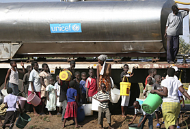 Women and children collect clean water from a UNICEF truck in Zimbabwe.