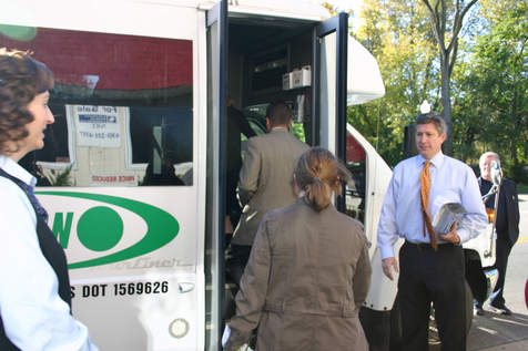 Jeff welcomes everyone as they get on the bus....
