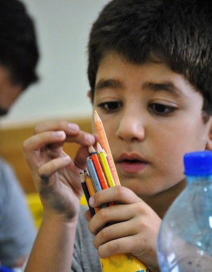 boy colored pencils