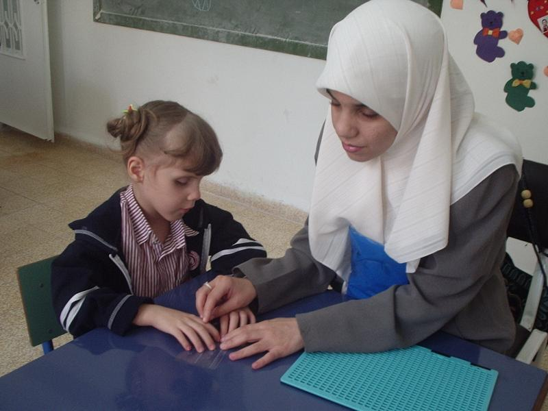 Irbid blind girl learning to read
