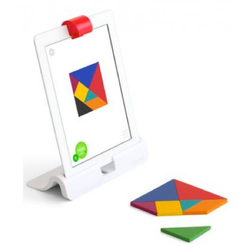 Image is of a iPad with a red plastic clip over the camera called an Osmos. The ipad is sitting on a white durable stand with pieces of plastic shapes to be used in making tangrams