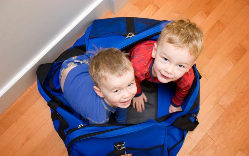 Boys in duffle bag