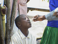 Musa John receiving neem drops