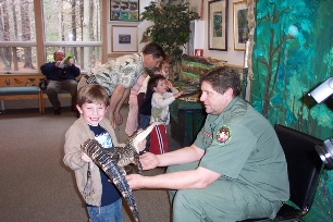 Child holding alligator