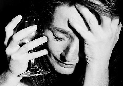 Sad woman with glass