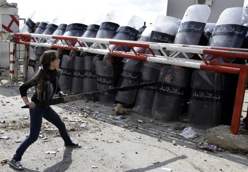 Woman Confronting Army Barricade