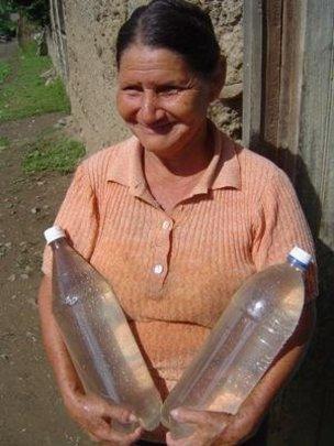 woman w/ 2 water bottles