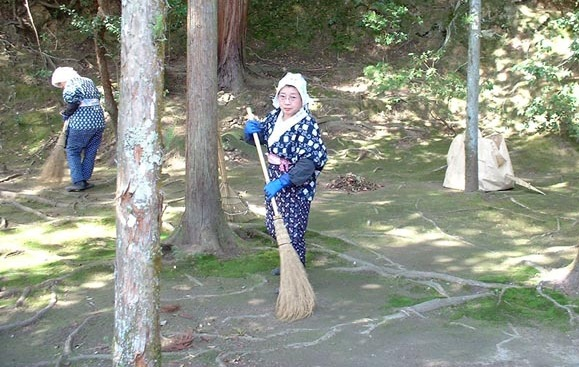 women sweeping