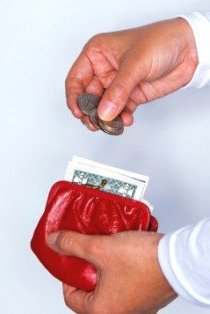 Handling money in a red wallet