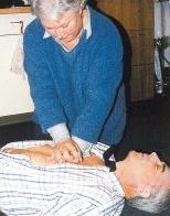 Woman giving man CPR