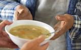 Patient receiving a bowl of soup
