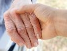 Old person's hand being held