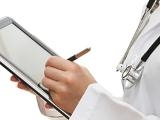 Doctor writing on an e-tablet