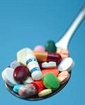 Spoonful of assorted pills