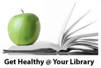 Granny Smith apple on an open book