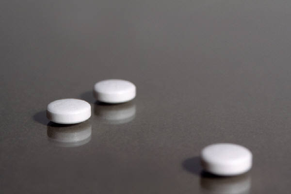 3 pills on a counter
