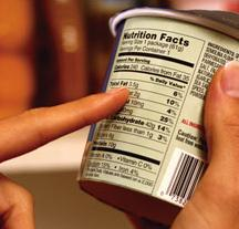finger pointing to a food label
