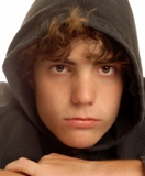 Close-up of teen boy in hooded sweatshirt
