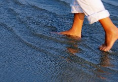 Woman wading in shallow water