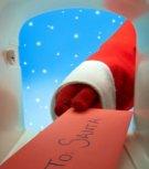 Santa taking letter from mailbox