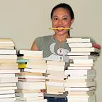 Woman with stacks of books