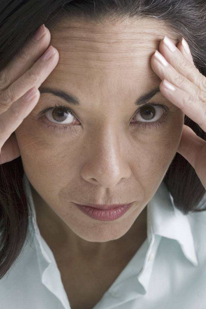 Close-up of a worried woman