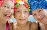 3 older women, happy in swim caps
