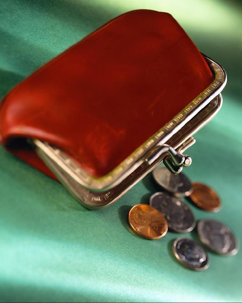 Coins spilling out of a change purse