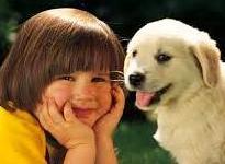 Close-up of kid & puppy