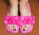 Woman's feet in pink fuzzy slippers