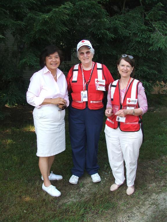 Karen at an event  with volunteers