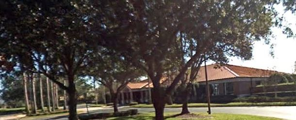 Tree lined street and office building