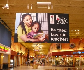 Be There banner hanging in Discover Mills