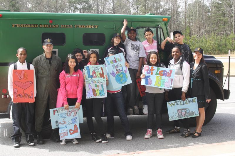 Berkmar Middle students welcome the Fundred armored truck
