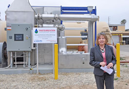 Cheryl Heitmann in front of the Pasteurization project