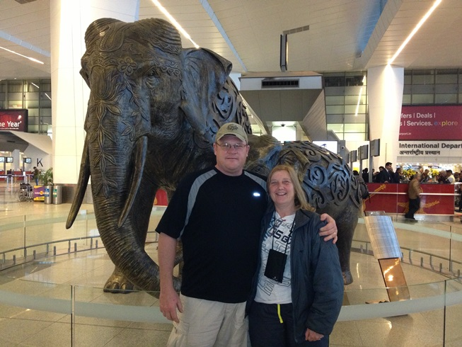 Jeff & Julie with elephant in New Delhi Airport