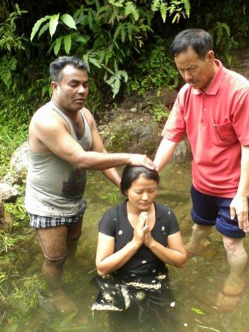 Baptizing new beliver.jpg