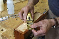 Planing a birdseye maple veneer