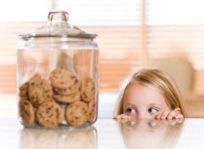 girl stealing cookie