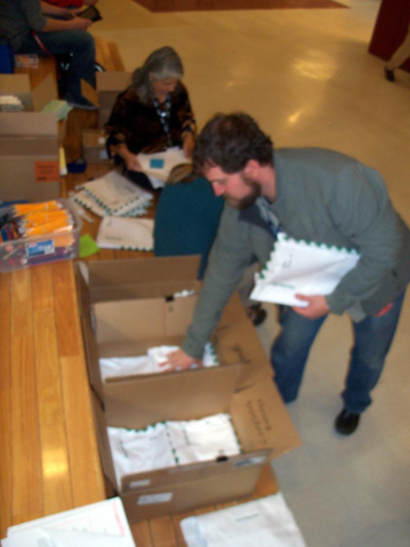 Celebrating Community Norms Coalition members Lauren Patterson and Greg Felson pack up the completed surveys