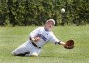 Baseball outfielder diving