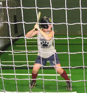 Girl Batter in Cage