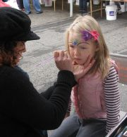 girl with flower face paint