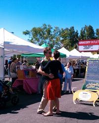 couple dancing at market