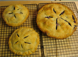 two mini pies and one big blackberry pie