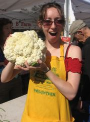 volunteer with a giant cauliflower
