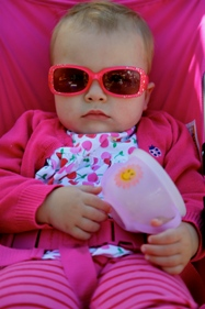 baby dressed in bright pink