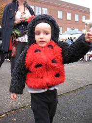 rain wary child in ladybug costume