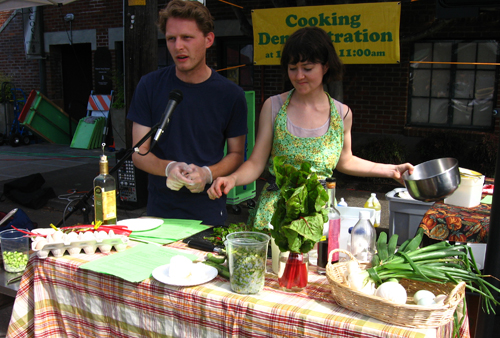 chefs demoing how to make fava bean salad