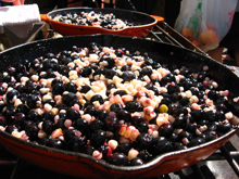 skillet full of berries and corn